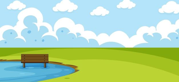 Paisagem de parque vazio com lago no prado