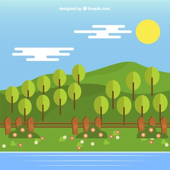 Paisagem de prados verdes com árvores e rio