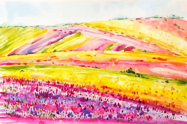 Paisagem de primavera em aquarela com campos de flores coloridas