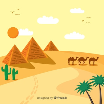 Paisagem do deserto com pirâmides e caravana