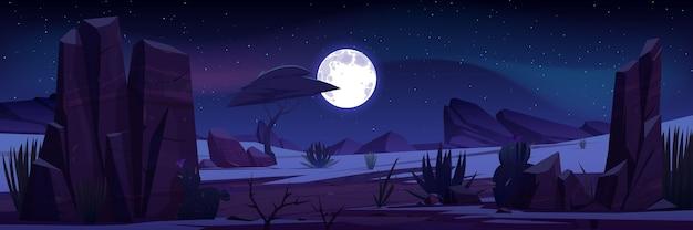 Paisagem do deserto com rochas, árvores tropicais, plantas e cactos à noite.