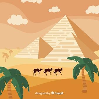 Paisagem do deserto egípcio com pirâmides e caravana