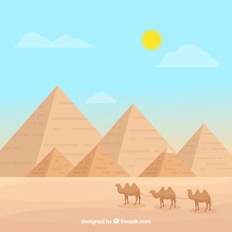 Paisagem do egito com pirâmides e caravana