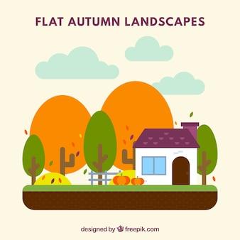 Paisagem do outono com casa e abóboras