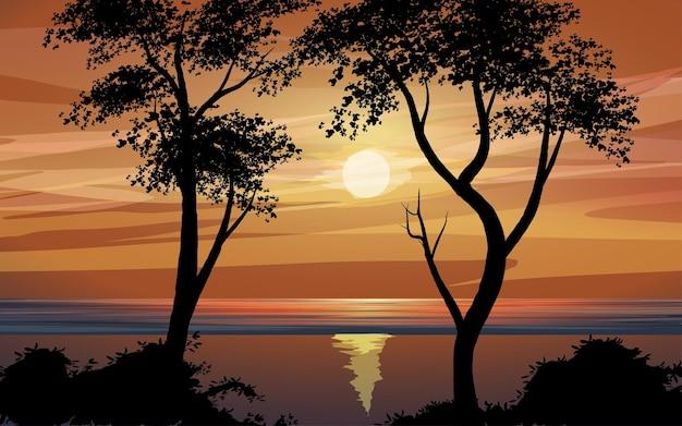 Paisagem do pôr do sol na praia com árvores