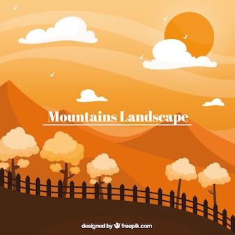 Paisagem laranja com montanhas, pôr do sol