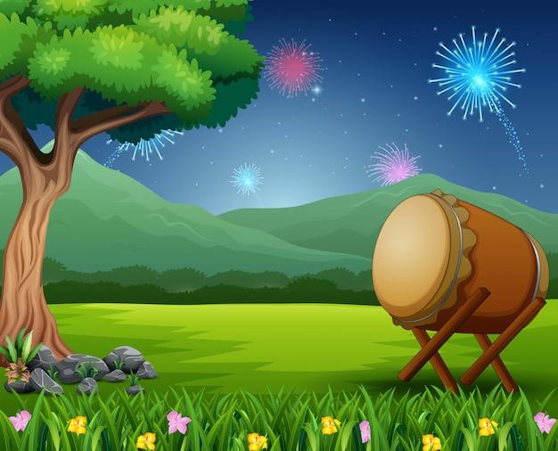 Paisagem natural com um tambor e fogos de artifício no céu