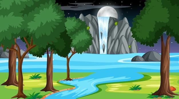 Paisagem natural da floresta à noite com cachoeira