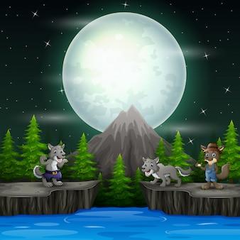 Paisagem noturna com três lobos nas rochas