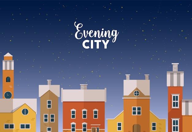 Paisagem urbana de inverno ao anoitecer com ruas urbanas, fachadas de belos edifícios e céu estrelado
