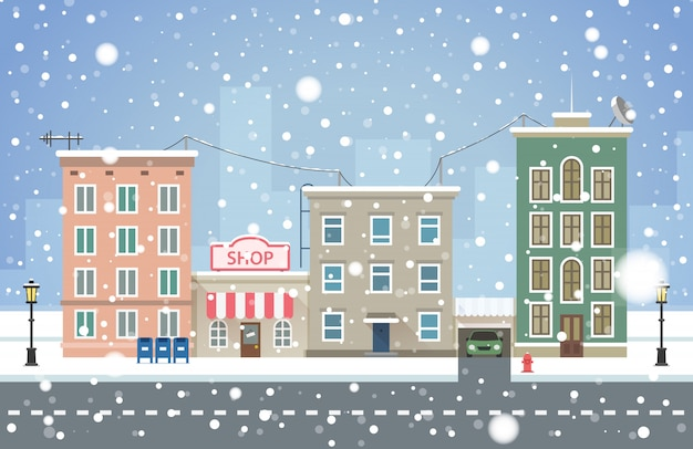Paisagem urbana de inverno. queda de neve na cidade pequena.