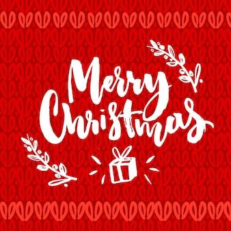 Palavras de feliz natal. texto da rotulação da escova na textura de malha vermelha. design de cartão de saudação de vetor.