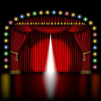Palco com cortina vermelha de abertura e luzes