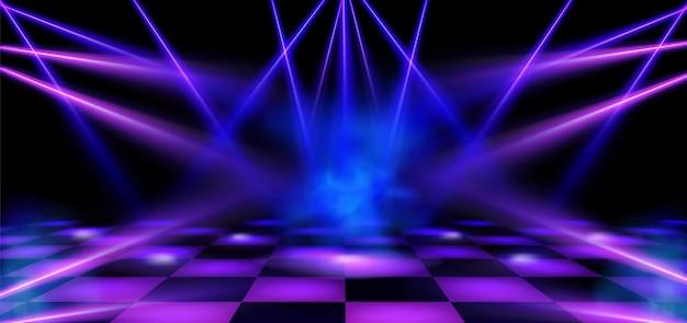 Palco da pista de dança iluminado por holofotes azuis e rosa