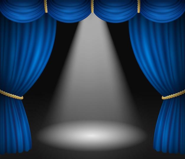Palco de teatro com cortinas azuis e holofote