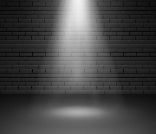 Palco iluminado por holofotes contra parede de tijolos