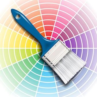 Paleta de roda de cores e pincel com cabo azul