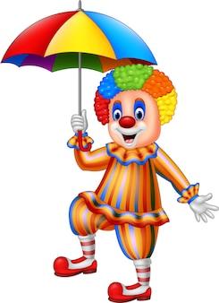 Palhaço engraçado dos desenhos animados, segurando um guarda-chuva