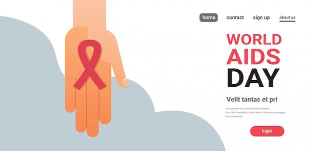 Palma de conscientização do dia mundial da aids segura fita vermelha sinal prevenção médica