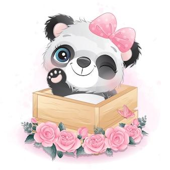 Panda pequeno bonito sentado dentro de uma caixa