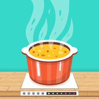 Panela no fogão com vapor