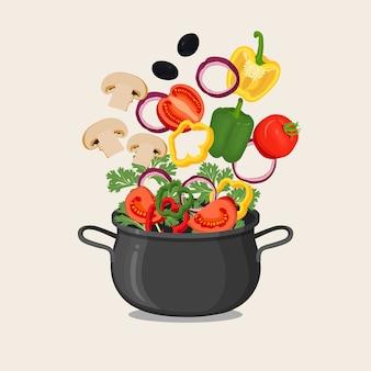 Panela preta com água fervente e vegetais