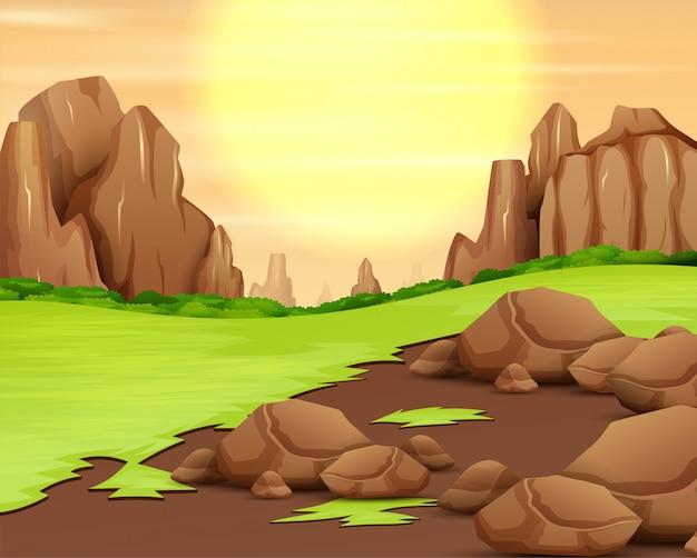 Panorama da montanha rochosa com o sol brilhar no céu