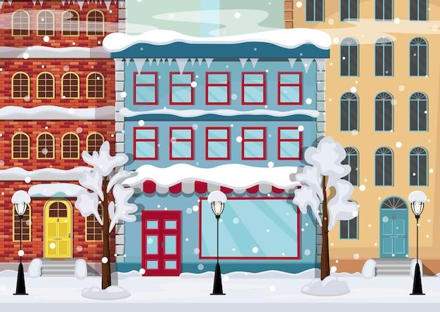 Panorama de uma cidade de inverno com árvores na neve, casas, lanternas, estrada.