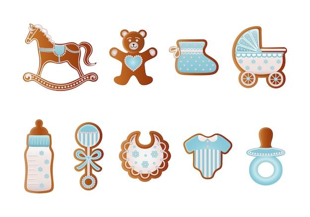 Pão de mel de gengibre. biscoitos azuis para menino. cavalo de balanço, urso, sapato de bebê, carrinho de bebê, biberão, chupeta, vestido, chocalho e biberão
