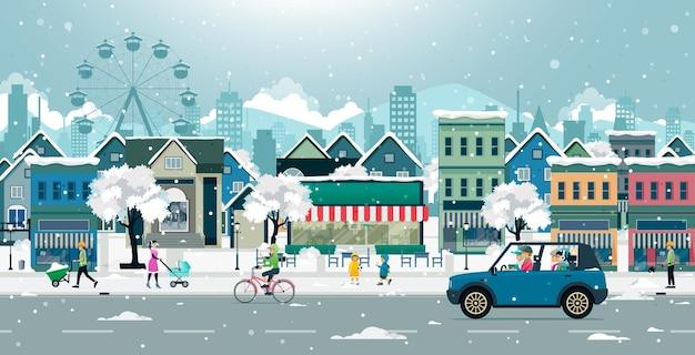 Papai estava dirigindo com a família em uma estrada com neve na cidade.