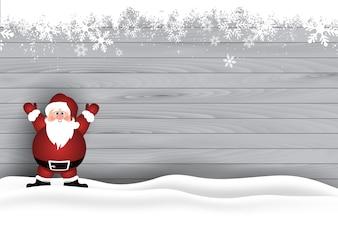 Papai Noel bonito na neve em um fundo de textura de madeira