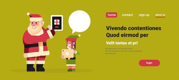 Papai noel com duende menina usando tablet aplicação on-line bate-papo bolha comunicação feliz ano novo feliz natal feriado