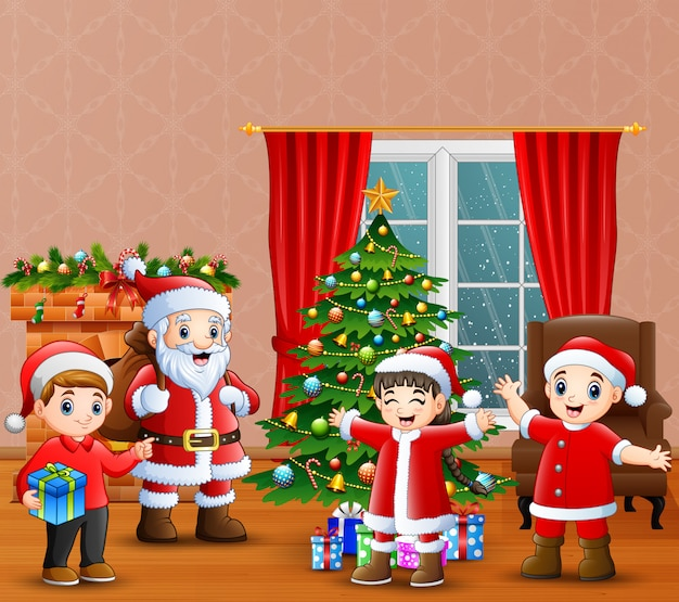 Papai noel e crianças comemoração um natal em casa