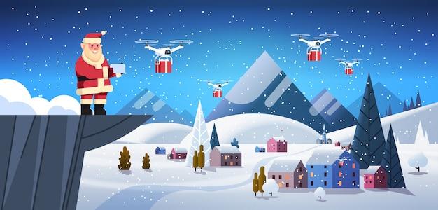 Papai noel no penhasco segure controlador drone entrega serviço sobre casas de vila de inverno