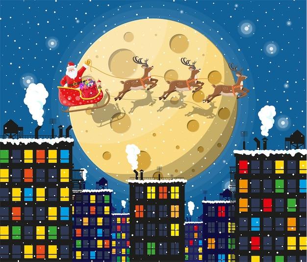 Papai noel no trenó e suas renas com a lua no céu