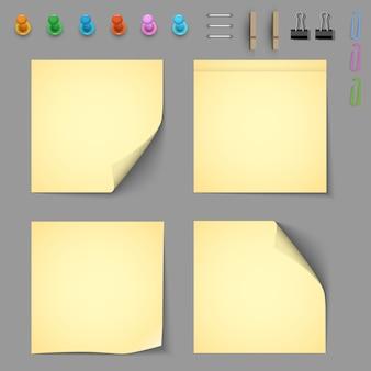 Papéis de aviso amarelo com elementos para anexar papel
