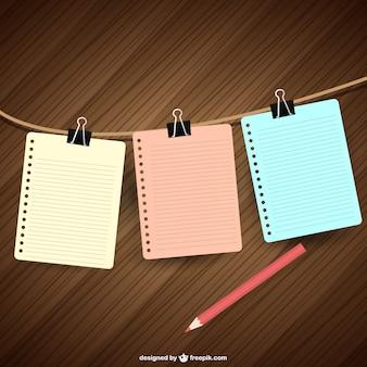 Papéis de notebooks pendurados vector