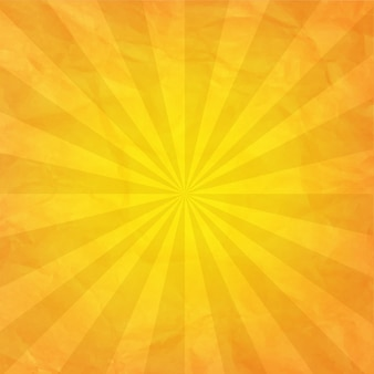 Papel amassado amarelo com sunburst