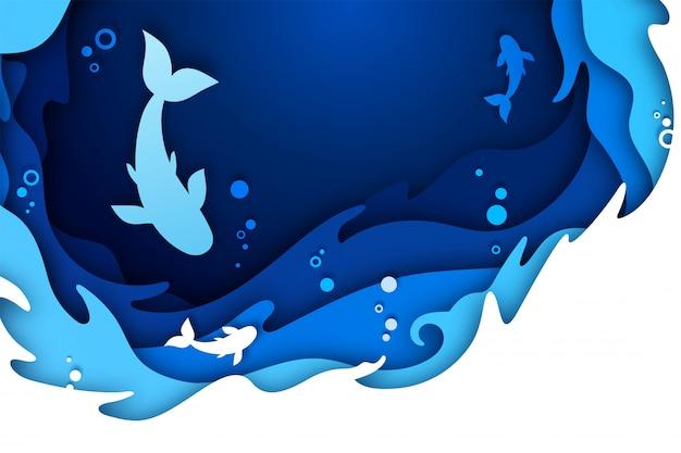 Papel art. mundo subaquático do oceano com peixes
