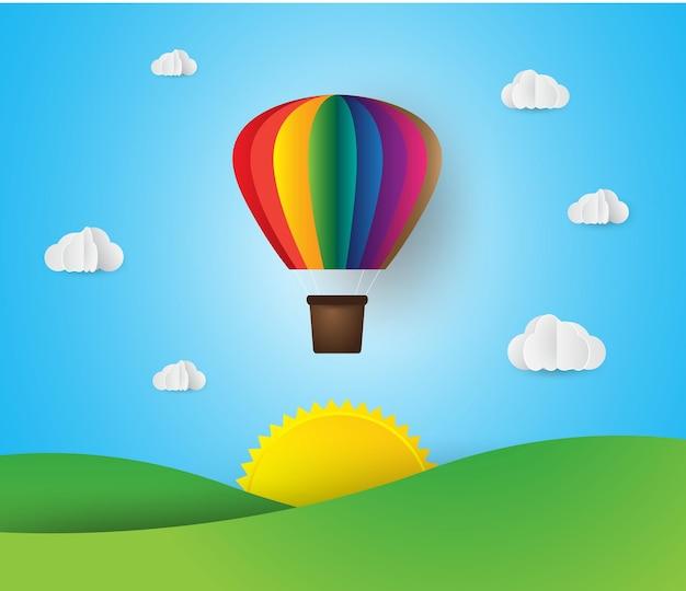 Papel arte estilo origami feito balão de ar colorido nuvem céu azul e pôr do sol
