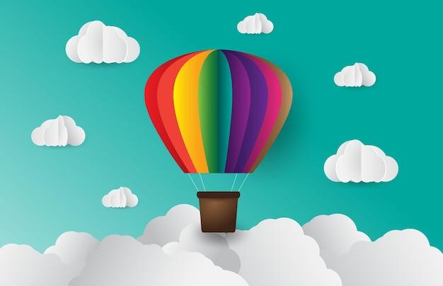 Papel arte estilo origami feito de nuvem colorida balão de ar céu azul