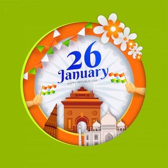 Papel cortado estilo poster design com monumentos famosos da índia e mãos humanas segurando bandeira indiana ondulada para 26 de janeiro, feliz dia da república.