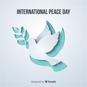 Papel cortado forma de pomba para o dia da paz