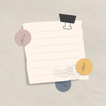 Papel de carta forrado em branco com clipe de pasta no fundo de papel texturizado