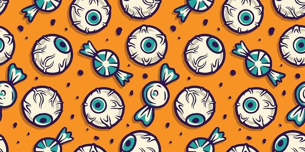 Papel de parede padrão de halloween com olhos e doces
