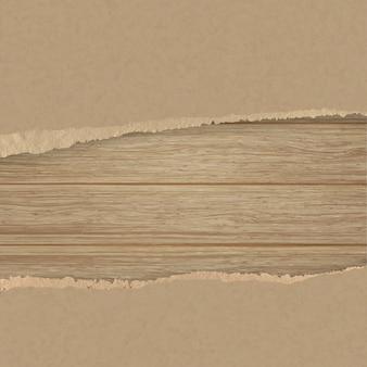 Papel de textura marrom rasgado sobre uma parede de madeira da prancha.