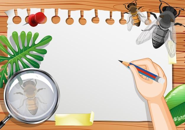 Papel em branco na vista de cima da mesa com folhas e elementos de insetos