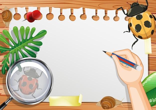 Papel em branco na vista de cima da mesa com folhas e elementos de joaninha