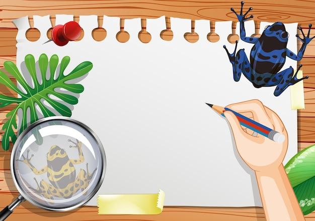 Papel em branco na vista de cima da mesa com folhas e elementos de sapo