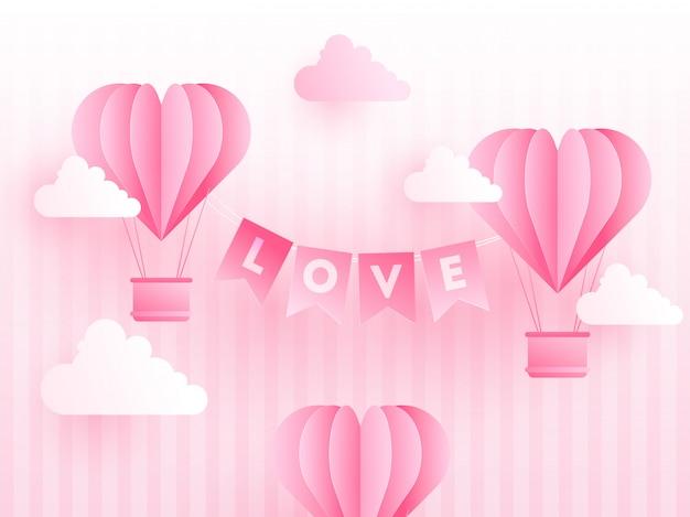 Papel origami de balões de ar quente de formas de coração com letteri de amor